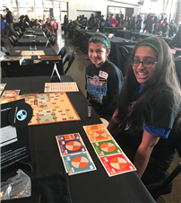 Photo of students playing the game during competition